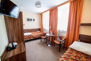 Łóżko lub łóżka w pokoju w obiekcie Sanatorium Energetyk