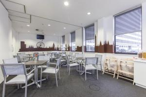 A restaurant or other place to eat at Mk Hotel London