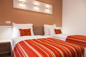Postel nebo postele na pokoji v ubytování Penzion Na Valech Hodonín