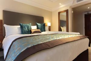 A bed or beds in a room at Amba Hotel Marble Arch