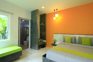 A bed or beds in a room at Aonang Paradise Resort Krabi
