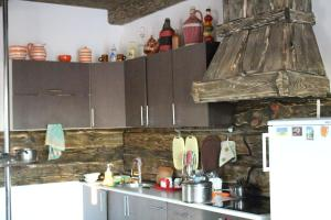 A kitchen or kitchenette at Your Hostel