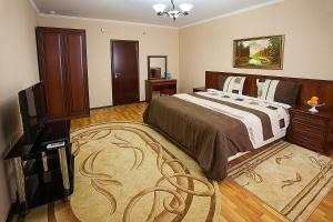 A bed or beds in a room at Sofia Resort