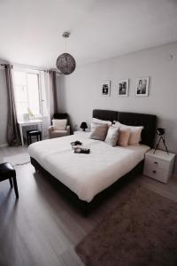 A bed or beds in a room at Fresh* Sheets Kathedral Dubrovnik