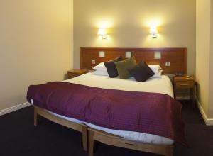 A bed or beds in a room at Imperial Hotel Galway