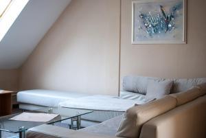Posteľ alebo postele v izbe v ubytovaní Penzión Evergreen