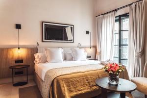 Łóżko lub łóżka w pokoju w obiekcie Sant Francesc Hotel Singular