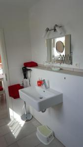 Ein Badezimmer in der Unterkunft BeHappy