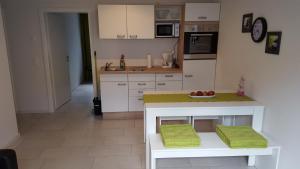Küche/Küchenzeile in der Unterkunft BeHappy