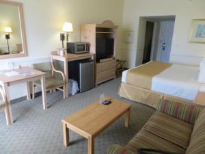 A television and/or entertainment center at Days Inn by Wyndham Daytona Oceanfront