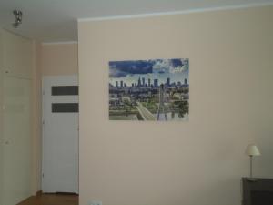 Telewizja i/lub zestaw kina domowego w obiekcie City Apartment
