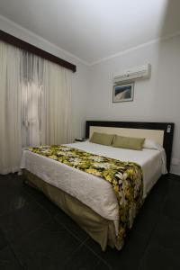 A bed or beds in a room at Flat Itararé Tower/Tecnoflat