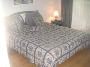 A bed or beds in a room at La ptit'Duch