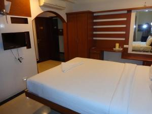 A bed or beds in a room at Sanu International