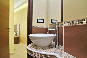 Um banheiro em Roma Suite Centro