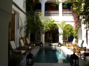 The swimming pool at or near Riad Les Yeux Bleus