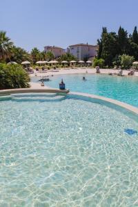 The swimming pool at or near Tartheshotel