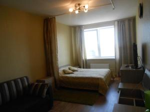 A bed or beds in a room at Apartments on Ostrovskogo 20A