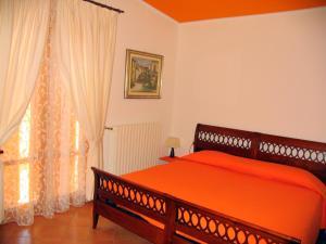 A bed or beds in a room at La Casa Dei Boschi