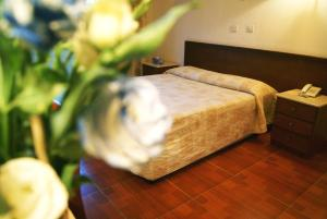 A bed or beds in a room at M. Moniatis Hotel