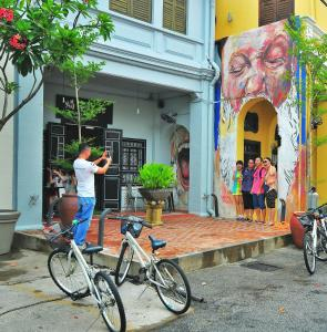 Biking at or in the surroundings of Ryokan Muntri Boutique Hostel
