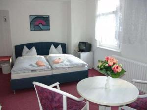 Ein Bett oder Betten in einem Zimmer der Unterkunft Hotel & Restaurant Märkische Schweiz