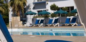 The swimming pool at or near Blue Crane Hotel Apts