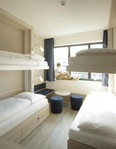 A bunk bed or bunk beds in a room at H2 Hotel Berlin-Alexanderplatz
