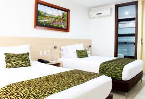 Cama o camas de una habitación en Hotel La Serrania Bucaramanga