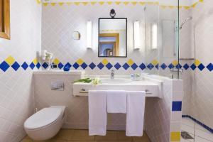 Een badkamer bij Seaside Sandy Beach