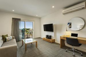 A television and/or entertainment center at Quest Townsville on Eyre