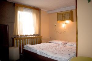 Кровать или кровати в номере Hotel-Penzion Johanka