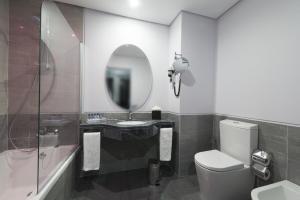 Um banheiro em Vila Gale Evora