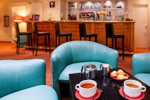 Restauracja lub miejsce do jedzenia w obiekcie Hôtel Continental