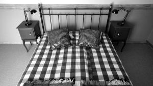 A bed or beds in a room at Zaku Krogs