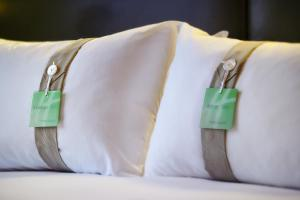 Кровать или кровати в номере Holiday Inn Paris Gare de Lyon Bastille, an IHG Hotel