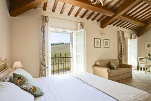 Un ou plusieurs lits dans un hébergement de l'établissement Borgo Conde Wine Resort