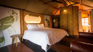 A bed or beds in a room at Lala Mukha Tented Resort Khao Yai