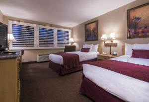 A bed or beds in a room at Grand Vista Hotel