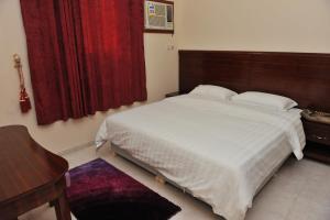 Cama ou camas em um quarto em Amasy Al Waha