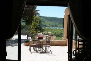 A porch or other outdoor area at Auberge des Salles