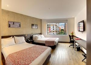 A bed or beds in a room at Hotel B3 Virrey
