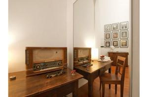 Télévision ou salle de divertissement dans l'établissement B&B Colori di Roma