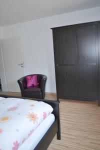 Ein Bett oder Betten in einem Zimmer der Unterkunft Fewo Larissa