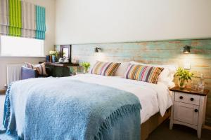 A bed or beds in a room at The Running Horse