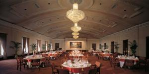 A restaurant or other place to eat at The Oberoi Grand Kolkata