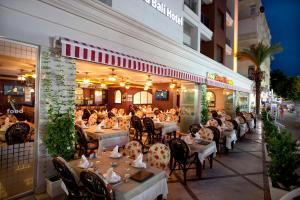 A restaurant or other place to eat at Xperia Grand Bali Hotel - All Inclusive