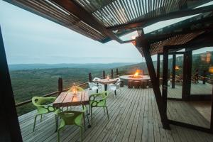 A restaurant or other place to eat at Rhino Ridge Safari Lodge