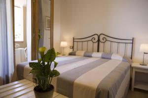 Letto o letti in una camera di Hotel Barsalini