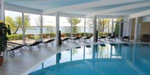 The swimming pool at or near Seehotel Schloss Klink